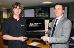 Success at his fingertips - Mercury Security financial director Eoin O'Brien presents Mark Ireland, a 16-year-old student from Strangford Integrated College in County Down, with a new laptop after he was short-listed as a finalist in a 'Dragon's Den' style competition run by Generation Innovation.