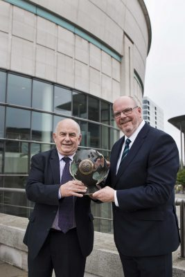 Brian Ogle and Jonathan Adair of Northern Ireland Travel News, organisers of the Northern Ireland Travel and Tourism Awards, with the new, specially sculpted World Globe for the Travel Agent of the Year which will be presented at the 25th Anniversary Awards in the Slieve Donard Resort and Spa later this year. The occasion was the launch of the 2016 Awards in Belfast's Waterfront Hall