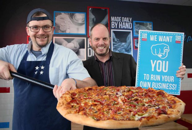 NEW YEAR NEW CAREER?: Four Star Pizza Director Brian Clarke (right) is on the hunt for ambitious Northern Ireland entrepreneurs who would like to make a fresh start and grab a slice of success with one of the country's largest pizza companies. Four Star Pizza (FSP) is planning to increase its number of Northern Ireland stores from 12 to 30 by 2019 and Brian, pictured here with Bangor store assistant manager Matt Tennant, is encouraging anyone with a good head for business to consider joining the company's growing list of franchisees. Interested parties do not need any previous pizza experience as FSP will provide all the necessary training in food preparation, accounts, customer service, delivery and marketing. Anyone interested in finding out more should call 00 353 1 7037300 or send an introductory email to info@fourstarpizza.ie. Four Star Pizza is a wholly owned Irish company that operates a total of 48 stores across the island of Ireland, including 12 in Northern Ireland. Established in 1988, the company opened its first Northern Ireland franchise on Belfast's Beersbridge Road in 1999 and other locations now include Bangor, Carrickfergus, Newry, Drumahoe, Derry, Armagh, Newtownabbey and most recently Coleraine which opened its doors in November last year.