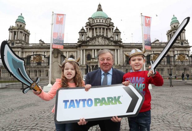 Raymond Coyle, Owner and Founder of Tayto Park with Daisy McLoughlin and Christian Kennedy in Belfast today to launch Tayto Park's new 2018 season with gates opening on Sunday March 18. Ireland's only theme park and zoo, based in Co Meath, Tayto Park is one of the most popular attractions on the island of Ireland and has become a huge hit with families and thrill seekers from Northern Ireland who now account for some 25 per cent of all visitors each year. The Park is now gearing up for its biggest season yet with over 100 attractions on site and the promise of more exciting new rides this year